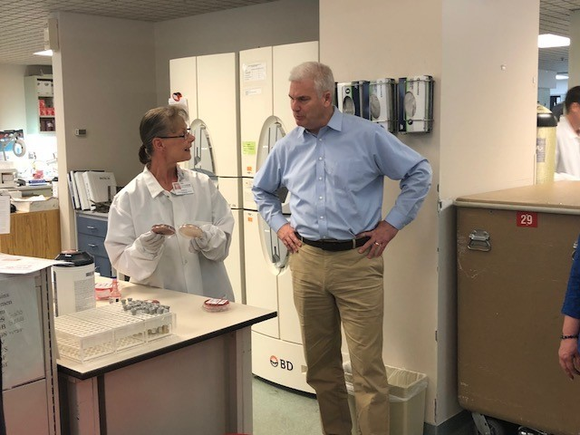 Edith Burlingame gives a tour of the laboratory to Minnesota Representative Tom Emmer